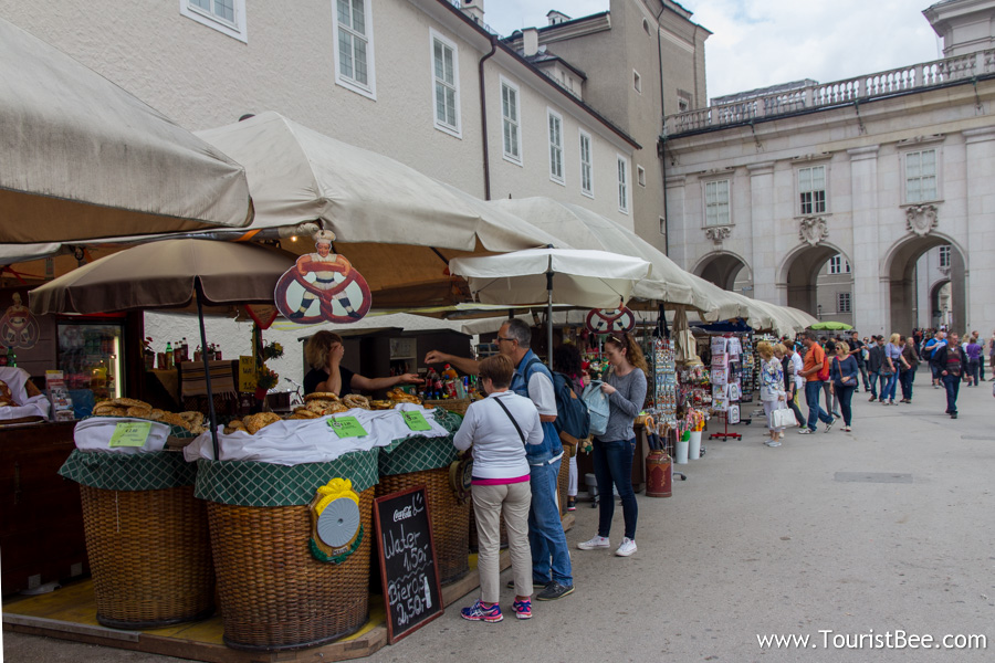 Salzburg, Austria - People buying fresh fruit and vegetables at a Sunday market inside Kapitelplatz