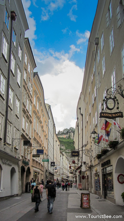 Salzburg, Austria - Getreidegasse is the main commercial street in old town Salzburg. It is a busy street with beautiful signs for each businesses.