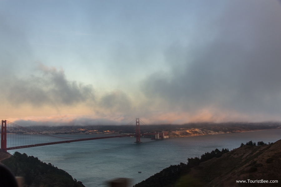 Golden Gate Bridge, San Francisco - Beautiful view of Golden Gate Bridge at sunset with clouds coming in from the ocean