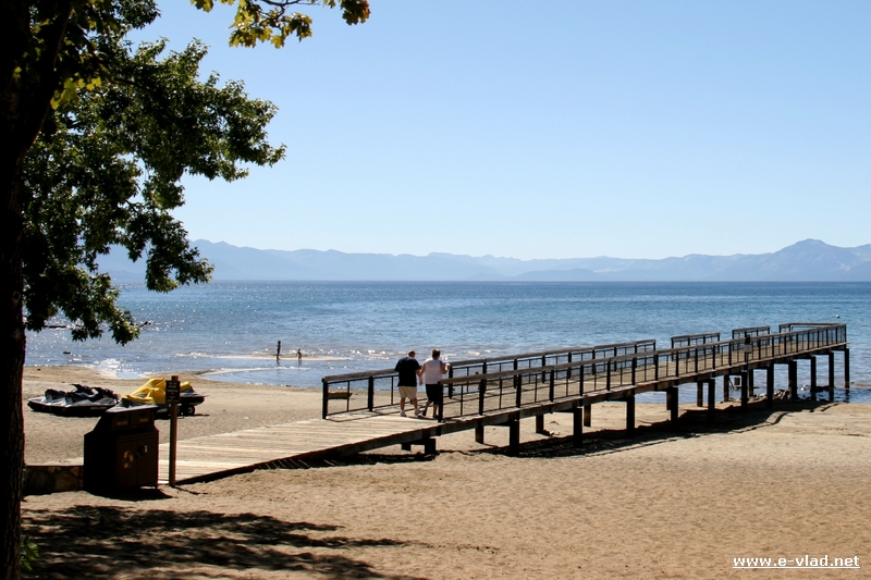 A small wooden boat dock leading into the water at King Beach, Lake Tahoe.