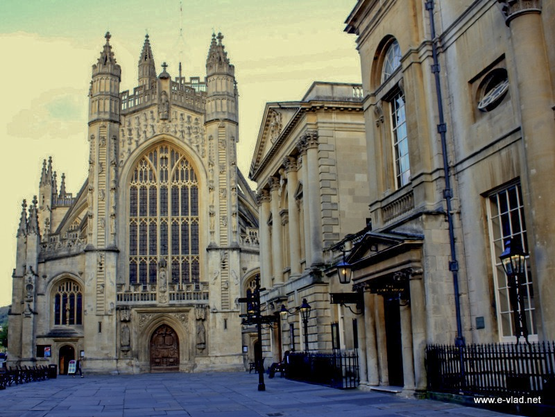 Bath, England - The Bath Abbey with the Roman Baths building on the right.
