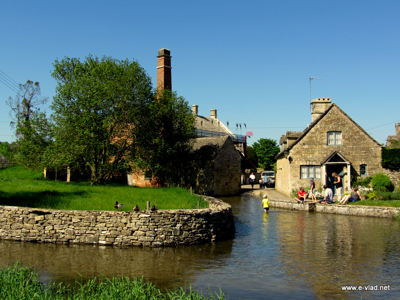 Lower Slaughter, England - The bend in River Eye and the water mill chimney.