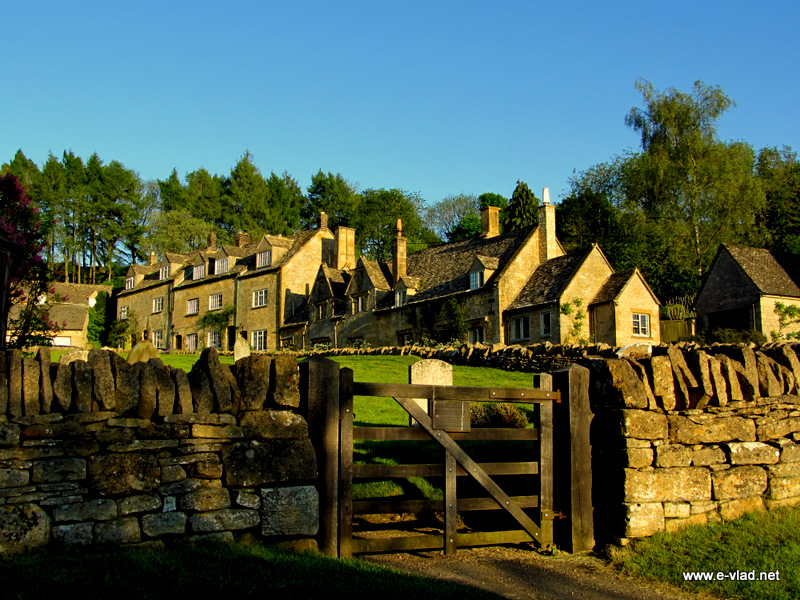 Showshill, England - Beautiful view of the gate to the church yard with stone houses in the background.