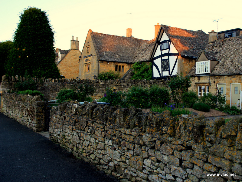Broadway, England - Old wall separating old houses on High Street.
