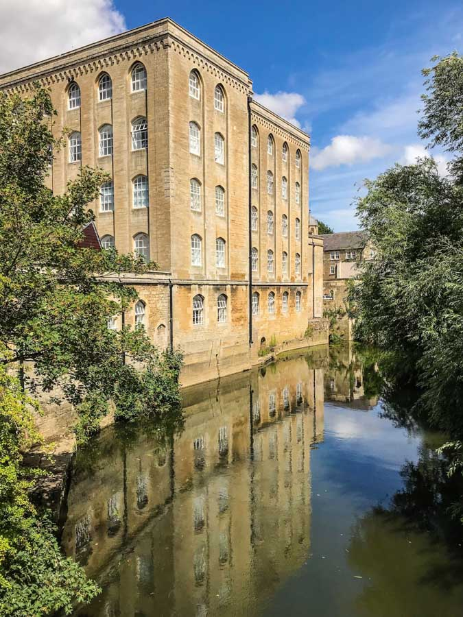 Bradford on Avon, Wiltshire - Tall building reflecting in River Avon