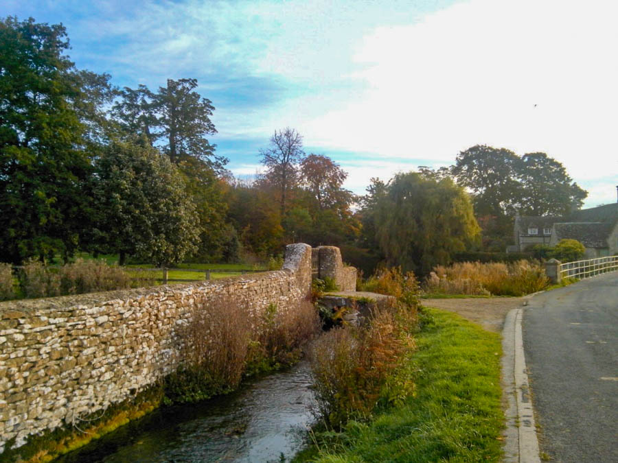 Fairford, Gloucestershire - Peaceful stream flowing by small stone wall