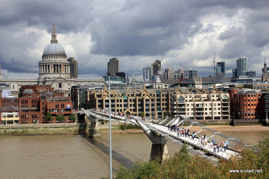 London, England - Beautiful view of Millenium Bridge and St Paul Cathedral from the balcony of the Tate Museum.