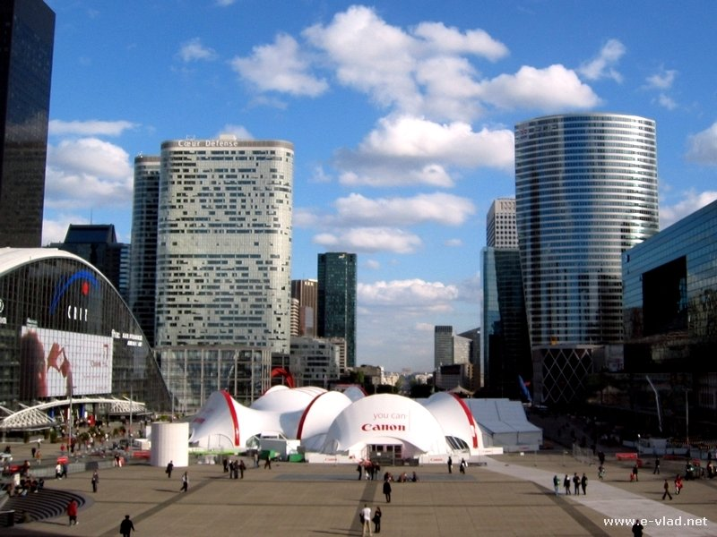 Modern buildings in La Defense are completely separated from the old city center was a very smart idea for Paris, France.