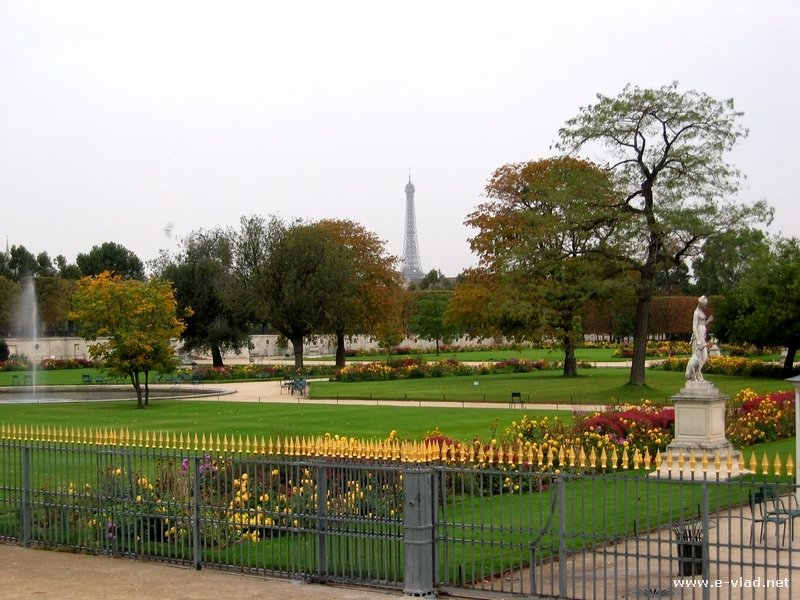 Paris, France - The Tuileries gardens in front of the Louvre Museum. The Eiffel Tower is visible in the distance.