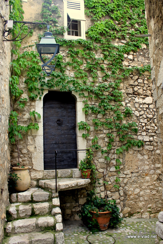 Saint Paul de Vence, France - Stone village house on a small cobbled stone street