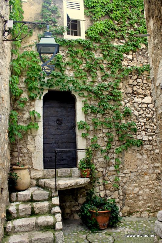 Saint Paul de Vence, France - Stone village house on a small cobbled stone street