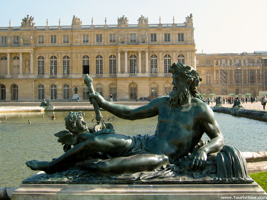 Versailles, France - Beautiful view of the Palace of Versailles from the large pool and statue