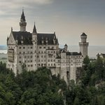 Neuschwanstein Castle, Germany - Beautiful front view of Neuschwanstein Castle from a secluded view point near the ski slopes in the village of Halblech