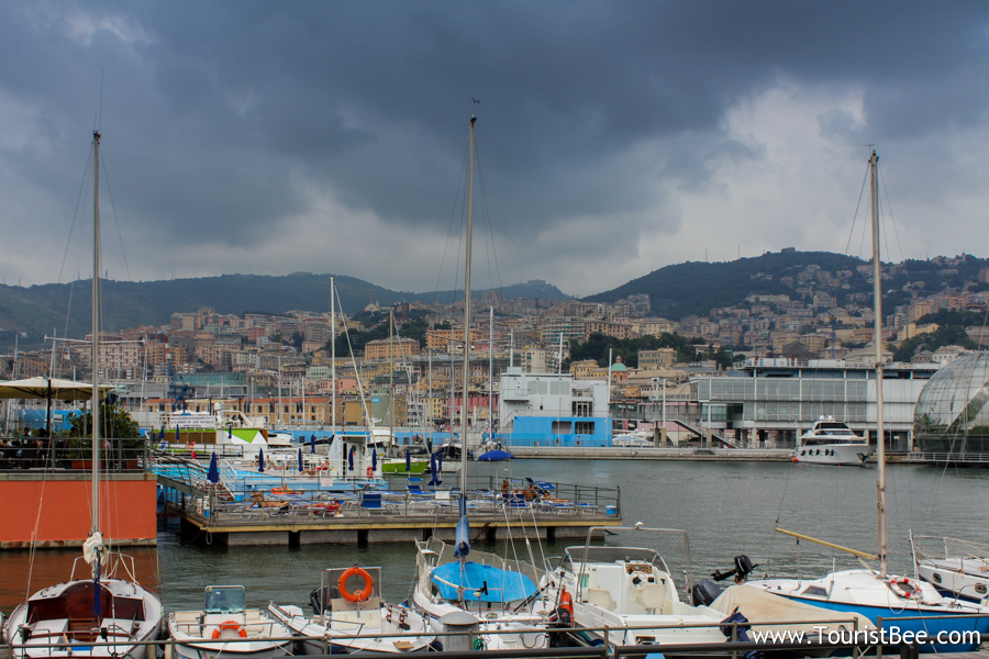 Genoa, Italy - The old port of Genoa (Porto Antico di Genoa) with a beautiful panorama of the colorful buildings spread on the hills in the background.