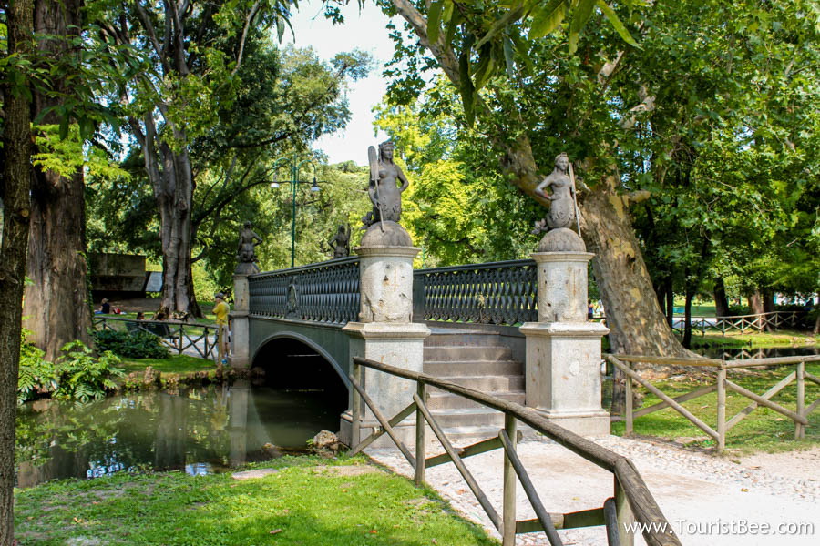 Milan, Italy - Beautiful old bridge in Parco Sempione behind Castello Sforzesco