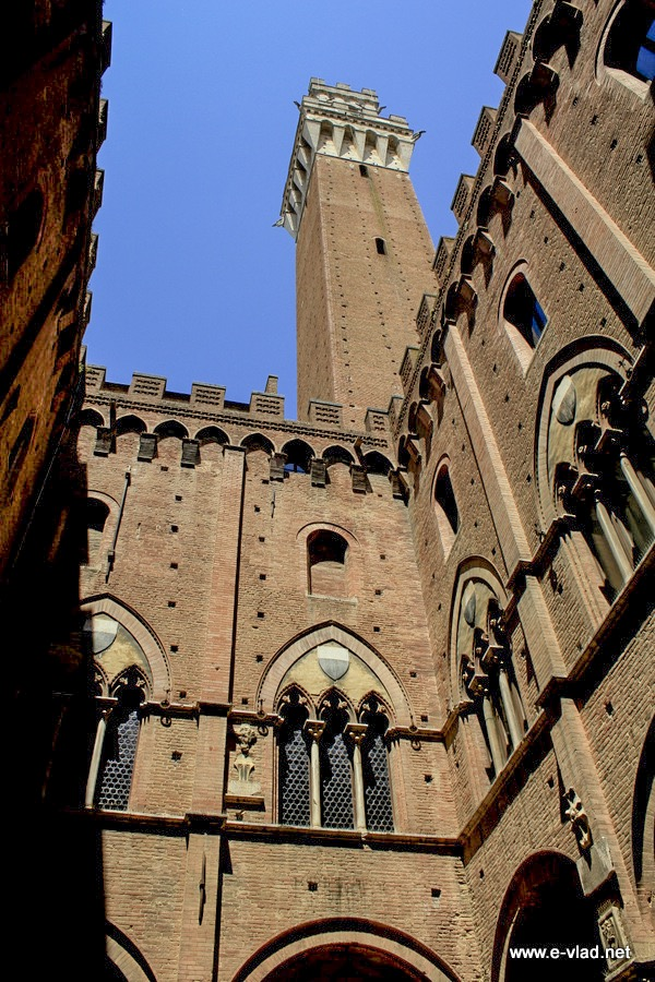 Siena, Italy - Torre del Mangia seen from behind Palazzo Publico.