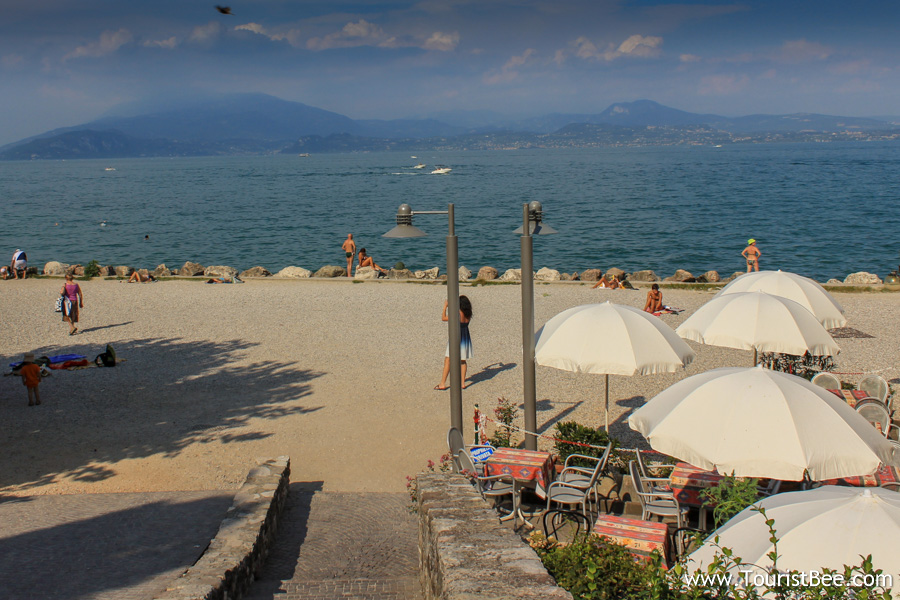 The east side of the Sirmione peninsula boasts a beautiful beach and a stunning view of Lake Garda and the far eastern shore.