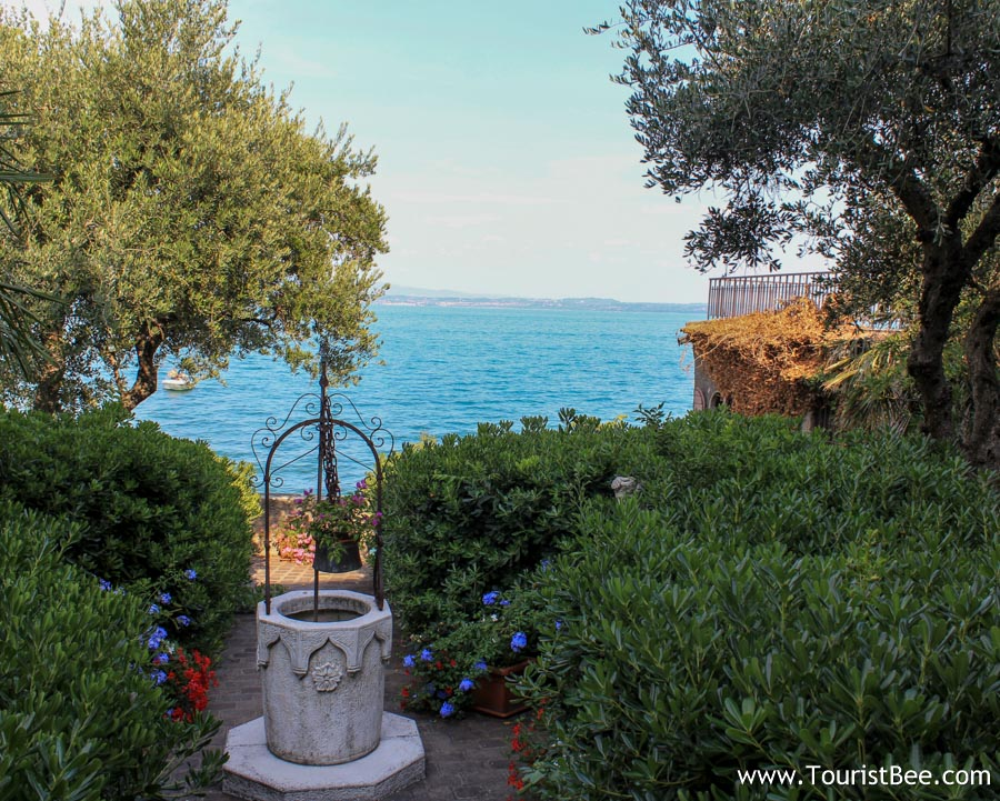 Sirmione, Italy - Old water well and beautiful view of Lake Garda from Santa Maria Maggiore courtyard