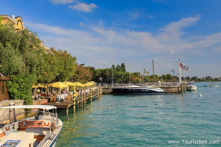 Sirmione, Italy - Boats docked on the western side of the village