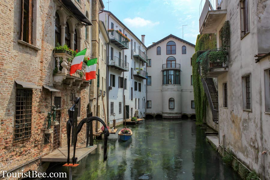 Treviso, Italy - Narrow water canal running through the medieval city