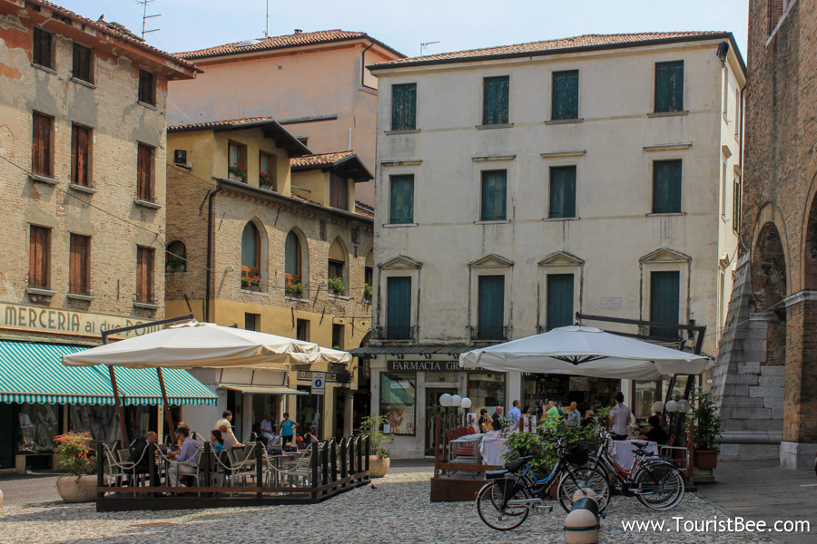 Old buildings and cafes near Palazzo dei Trecento