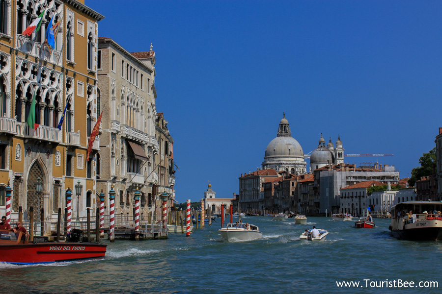 Venice, Italy - Beautiful buildings and Grand Canal with Santa Maria della Salute church in the background.