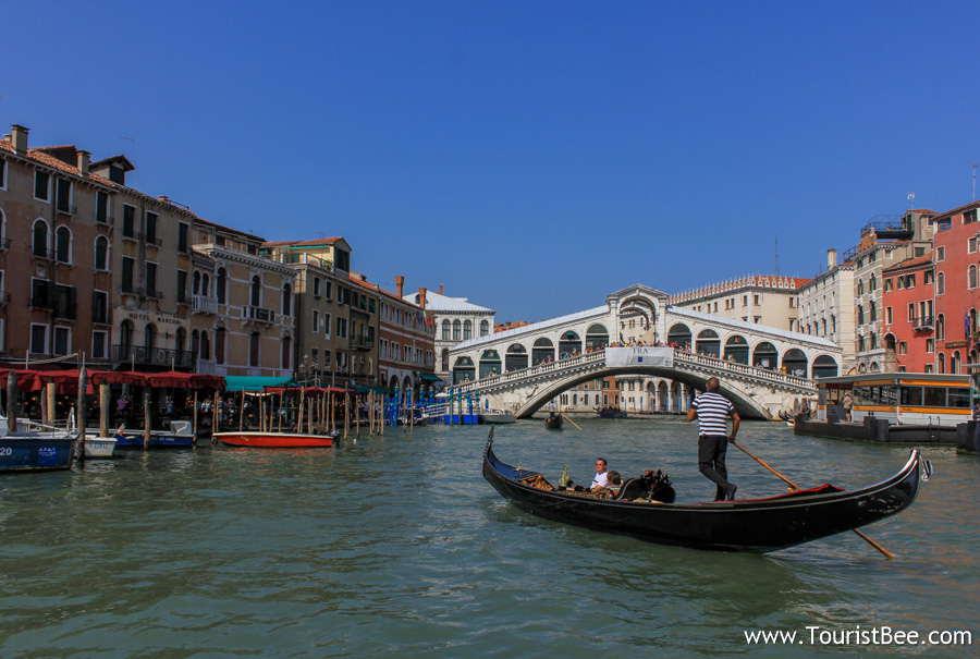 Venice, Italy - Gondola on Grand Canal with the beautiful Rialto Bridge in the background