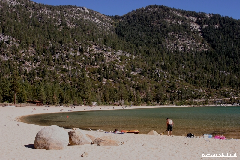 Man scanning for metals on the sandy beach of Sand Harbor at Lake Tahoe.