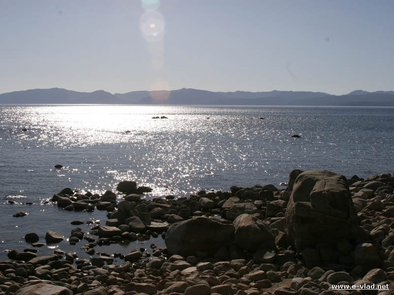 The sun shining in the clear water of Lake Tahoe close to sunset. This is the view you can enjoy from the Sand Harbor walkway.