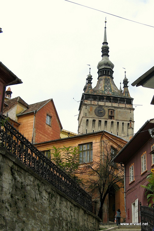 Climbing stairs to get to the fortress in Sighisoara, Romania.