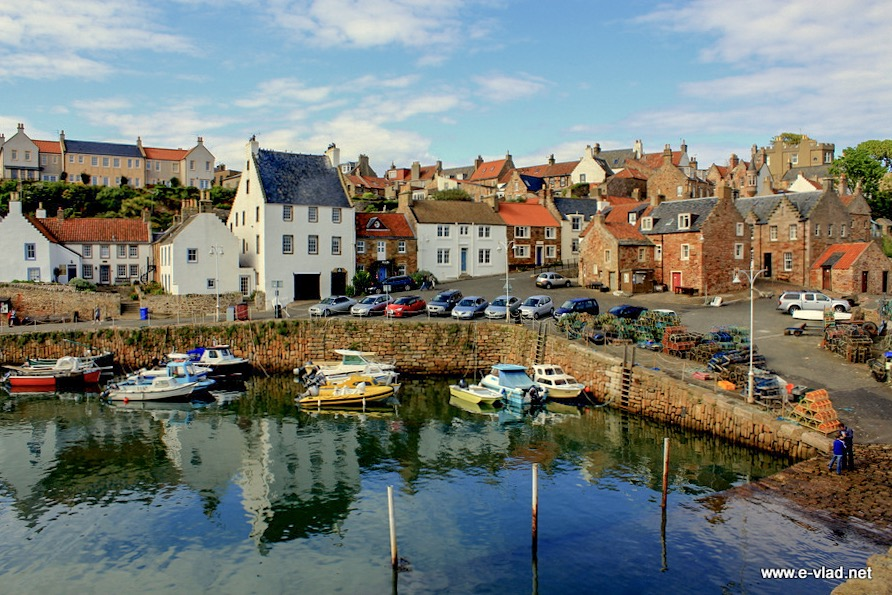 Crail, Scotland - Amazing blue sea water showing reflection of colorful village houses.