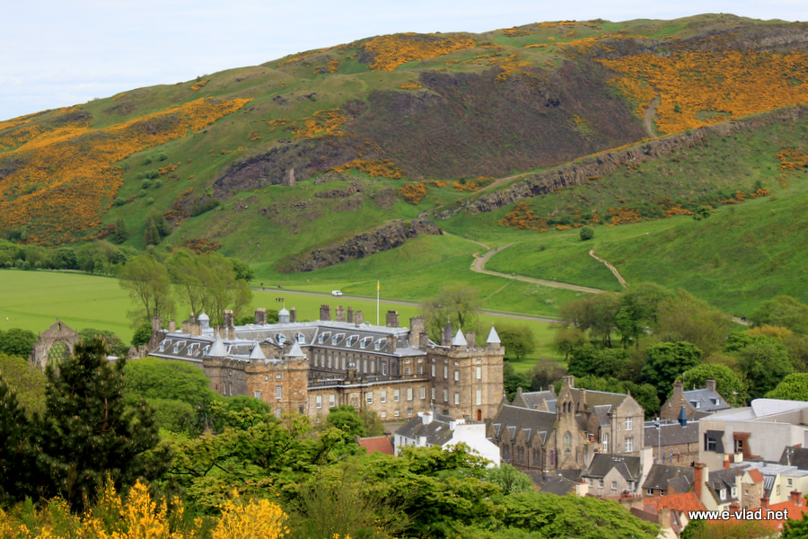 Edinburgh, Scotland - The Royal Palace of Holyrood and the large Arthur's Seat hillside seen from Calton Hill.