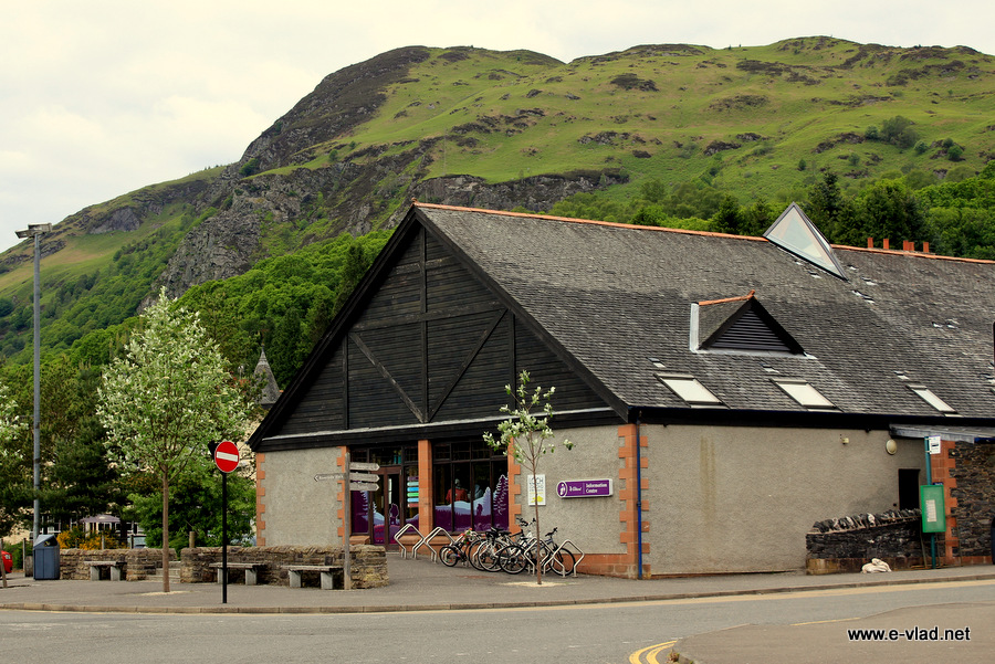 Loch Lomond & Trossachs - The Tourist Information building in Aberfoyle with the beautiful green hills in the background