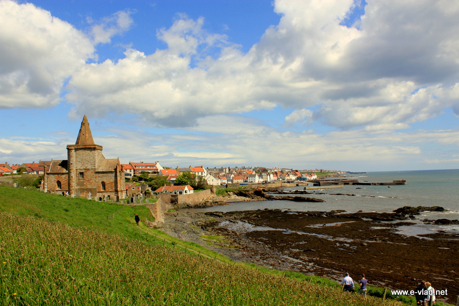 St. Monans, Scotland - People walking toward the village on the beautiful coastal trail.