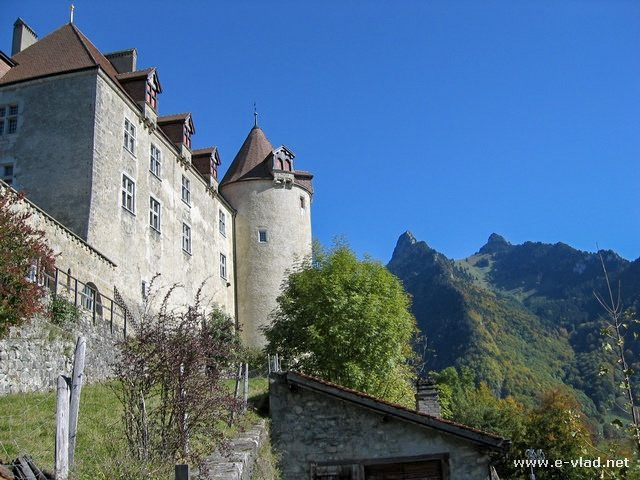 The castle in Gruyers sits on a hilltop overlooking the mountains
