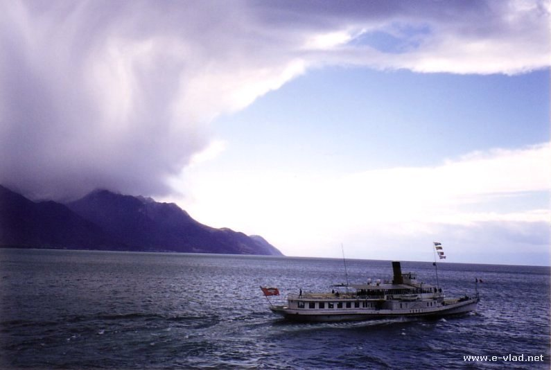 Montreux, Switzerland - Beautiful view of a tour boat on Lake Geneva as storm clouds start to gather.