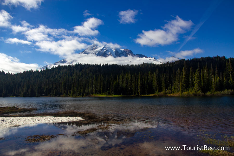Mount Rainier National Park - Mount Rainier seen reflected in a small mountain lake.