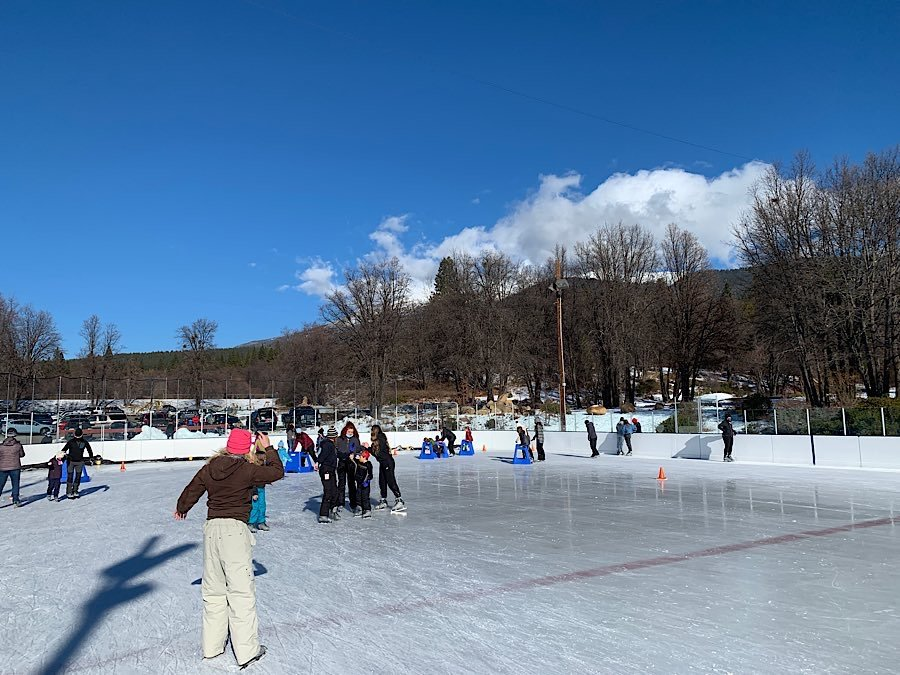 Ice Skaters on a beautiful sunny day at Siskiyou Ice Rink